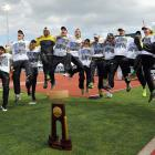 The Oregon men's team jumps for joy after winning the Men's Outdoor Track & Field National Championship, the first time in 30 years. The Oregon men won the indoor title as well (not pictured).
