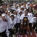 Members of the Texas A&M team celebrate after winning the Outdoor Track & Field Championship, their fourth in six years. Oregon's women (not pictured), won the Indoor Championship.