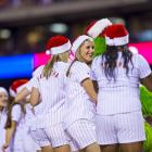 The ball girls dance with the Phanatic on top of the dugout during a game between the Phillies and Diamondbacks at Citizens Bank Park in Philadelphia, PA.