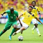 Yaya Toure of the Ivory Coast and Abel Aguilar of Colombia compete for the ball during the Group C match between Colombia and Cote D'Ivoire.