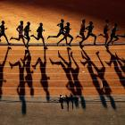 Athletes compete in the Men's 10,000m final at Hampden Park during Day Nine of the Glasgow 2014 Commonwealth Games on August 1, 2014 in Glasgow, United Kingdom.