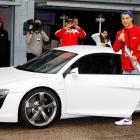 Real Madrid player Cristiano Ronaldo getting in his striking white Audi.