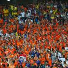 Fans of the Netherlands cheer during the Group B match between Spain and Netherlands at Arena Fonte Nova on June 13.