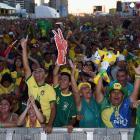 Brazil fans celebrate the first goal scored by Neymar.
