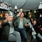 French fans celebrate the second goal of the match against Honduras, while watching the game in Paris Café, 'La Divette De Montmatre.'