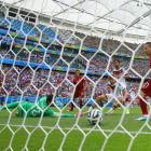 Thomas Muller scores one of his three goals in Germany's Group G-opening 4-0 rout of Portugal.