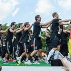 Germany's players perform a conga line.
