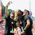 Lukas Podolski, Jerome Boateng and Mesut Oezil.