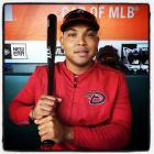 Yasmany Tomás of the Arizona Diamondbacks poses for a portrait in the dugout during batting practice before the game against the San Francisco Giants at AT&T Park in San Francisco on Fright night, September 18, 2015.