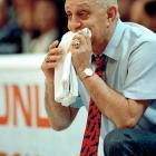 Jerry Tarkanian chews on his towel while watching his Runnin' Rebels take on Duke in the 1990 championship game. UNLV would go on to win 103-73.