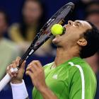Jo-Wilfried Tsonga takes a healthy bite out of a tennis ball after missing a point against Juan Martin del Potro during the 2008 Tennis Masters Cup in Shanghai.