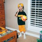 Johnny Manziel, age 4, shows off his allegiance to the Packers.