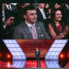 Johnny Manziel listens while Host Jon Hamm speaks onstage at The 2013 ESPY Awards at Nokia Theatre L.A. Live on July 17, 2013.