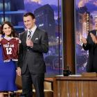 "Megan Fox, then a new mother, holds a customized Texas A&M jersey Johnny Manziel gave her while taping ""The Tonight Show with Jay Leno"" on Dec. 17, 2012 in Burbank, Calif."