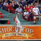 A leaping catch by Kole Calhoun prevented a three-run homer by Boston's Brock Holt and helped the Angels win 4-3 on Tuesday.