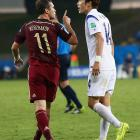 Aleksandr Kerzhakov and Han Kook-Young exchange words during their match on June 17.