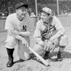 Gehrig and Cardinals pitcher Dizzy Dean talk together before a game.