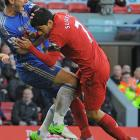 """Liverpool striker Luis Suarez of Uruguay bit Chelsea defender Branislav Ivanovic's arm during a Premier League match on April 21, 2013, before scoring his 30th goal of the season - a last-gasp equalizer - to clinch a 2-2 draw. """"For my unacceptable behavior yesterday, the club has fined me today,'' Suarez wrote on his Twitter and Facebook accounts. Suarez did not face a police investigation after Ivanovic said he did not want to press charges. """"He had no apparent physical injuries and did not wish to make a complaint,'' Merseyside Police said in a statement. Suarez was suspended for seven matches in 2010 while playing for Ajax after biting a player."""