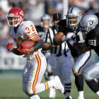 """Marcus Allen had played his whole career as a member of the home team at the Coliseum. He played four years there with USC, and then 11 more as a Raider. But on Nov. 14, 1993, Allen made his first visit to the Coliseum as a member of the visiting Chiefs. After receiving an ovation from the sellout crowd, Allen rushed for 85 yards and made several big plays that carried the K.C. to a 31-20 victory. After one such play, a Raiders fan yelled up to Al Davis' private booth, """"Nice move, idiot,"""" in reference to letting Allen slip away. It was as if he said what everyone was thinking that day."""