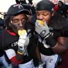 Mardy Gilyard and Ricardo Mathews of the Cincinnati Bearcats enjoyed some oranges after a 2008 victory over Syracuse. The Bearcats defeated the Orange 30-10 to claim the Big East title and a spot in the Orange Bowl.