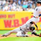 New York's Mark Teixeira reaches second base safely when White Sox shortstop Alexei Ramirez can't make the catch during their game on August 23. The Yankees won 5-3.