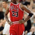 Bulls guard Michael Jordan chews his jersey following a call against him during a game against Seattle.