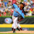 Mo'ne Davis, a 5-foot-4 inch, 111-pound eighth grader, throws during one of her appearances in the Little League World Series.