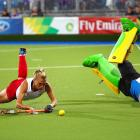 Australian goalkeeper Rachael Lynch blocks a penalty shot by Alex Danson of England during the Women's Gold Medal Match against England at Glasgow National Hockey Centre during Day Ten of the Glasgow 2014 Commonwealth Games on August 2, 2014 in Glasgow, Scotland.