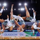 Rebecca Downie of England competes on the Beam during the Women's Gymnastics Artistic Team Final at SECC Precinct during day six of the Glasgow 2014 Commonwealth Games on July 29, 2014 in Glasgow, United Kingdom (Editor's Note: Multiple exposures of the camera were used to create the picture).