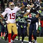 Moments after he deflected a pass to send Seattle to the Super Bowl, Richard Sherman (right) became the most debated athlete in America for at least a full week. His boisterous interview with sideline reporter Erin Andrews caused most of the furor, but he added fuel to the fire with an ill-advised exchange with Niners receiver Michael Crabtree and choking gestures he made shortly thereafter.