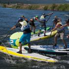 Pileup led by Michael Tavares at buoy two during the men's sup cross final.