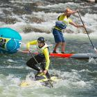 Maui's Kody Kerbox leading one of the men's SUP (stand up paddle) downriver sprint heats.
