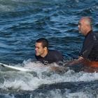 Blind surfer Derek Rabelo is guided to the wave by his father and coach, Ernesto Rabelo.