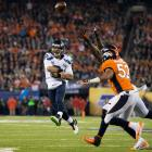 Armed with the NFL's No. 1 defense and a second-year quarterback well beyond his years, the Seattle Seahawks crushed the Denver Broncos 43-8 in one of the most lopsided Super Bowls in years.
