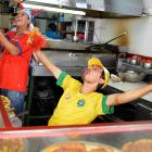 Workers at a pizza store in San Jose, Costa Rica, celebrate their team's goal against Uruguay as they watch the World Cup.
