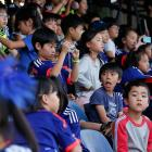 Students of a Japanese school in Sao Paulo watch a training session of Japan in Sorocaba, Brazil, Sunday, June 8.  Japan plays in Group C of the 2014 World Cup.