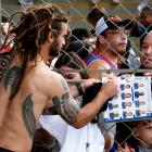 United States' Kyle Beckerman signs autographs following a training session at the Sao Paulo FC training center in Sao Paulo on June 11.