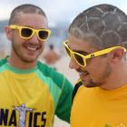 Two Australian football fans show off their football style haircuts at Copacabana beach on June 11.