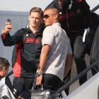 Belgian soccer players Vincent Kompany, center, Romelu Lukaku, top right, and Jan Vertonghen pose for a selfie prior to embarking the plane, departing from Brussels airport to Sao Paulo Brazil on June 10. Belgium will play against South Korea, Russia and Algeria in Group H.