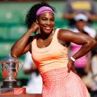 Serena Williams poses with the Coupe Suzanne Lenglen trophy after winning the singles final against Lucie Safarova at the 2015 French Open.