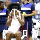 Serena Williams wipes sweat away after falling 3-0 in the first set to Bethanie Mattek-Sands at the U.S. Open.