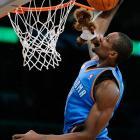 Thunder forward Serge Ibaka bites a stuffed animal during the 2011 NBA All-Star Saturday Night slam dunk contest in Los Angeles.
