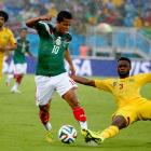 The Mexico-Cameroon game was played in a steady rain.