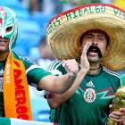 Mexico fans show their support prior to the Cameroon-Mexico game.