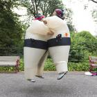 A hearty chest bump before the annual 5k charity fun run around London's Battersea Park.
