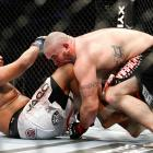 Tim Hague samples the knee of Joey Beltran during their heavyweight bout at UFC 113 in Montreal. Beltran would win by unanimous decision.