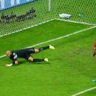 American goalie Tim Howard saves Belgian defender Vincent Kompany's shot in the second half.