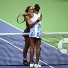 Serena and Venus hug after their quarterfinal match at the 2015 U.S. Open.