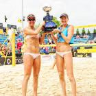April Ross and Kerri Walsh Jennings with the trophy