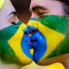 Two Brazilian soccer fans share a kiss ahead of the World Cup Round of 16 match between Brazil and Chile at Estadio Mineiraõ in Belo Horizonte, Brazil.